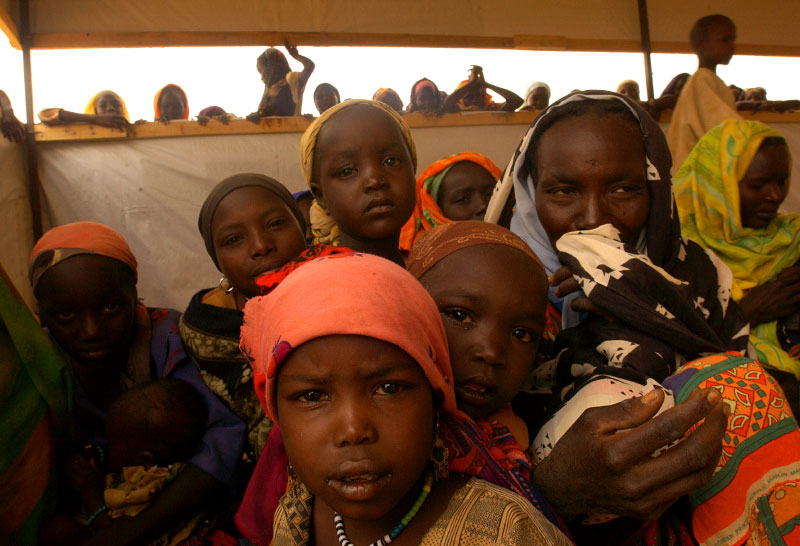 Sudanese refugees wait for their turn to be registered by UNHCR, UN refugee agency, at Kashuni Refugee camp. Majority of refugees in the camp were women and children because many men were targeted and killed during the raid by the Janjaweed, or stayed behind to protect their land.