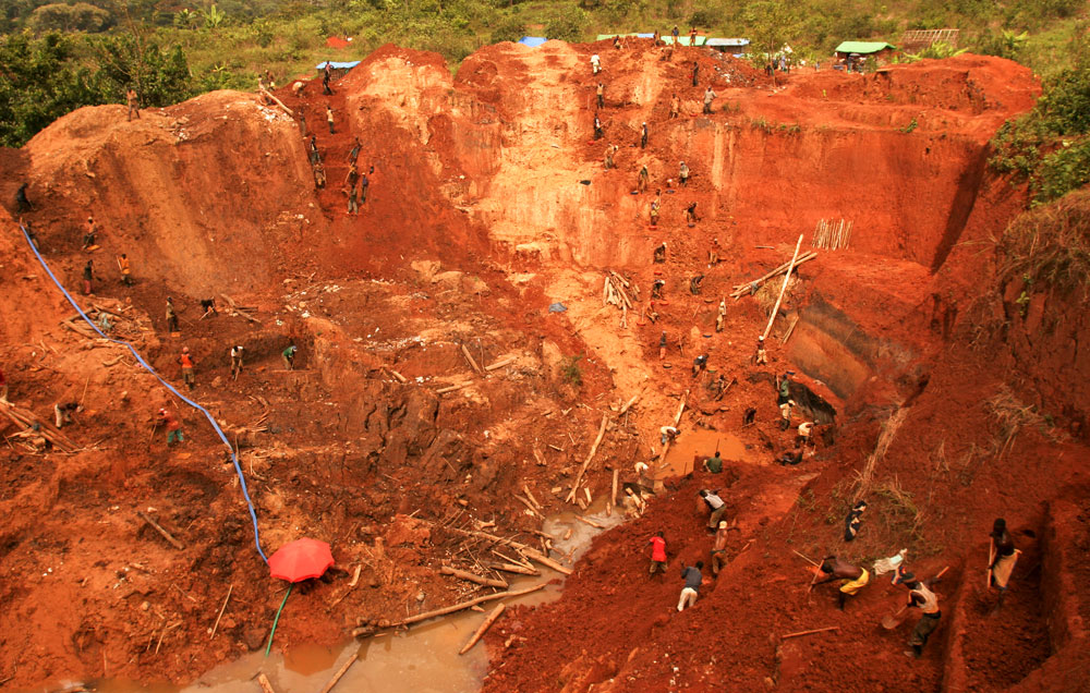 Gaping hole at an artisan goldmine in Montgbawalu. In order to make ends meet, young and old spend all day digging for a few ounce of gold without any help from modern machinery.  Most of the gold corrected is sold across the border in Uganda.