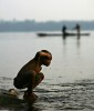 Young boy came down to bathe on the bank of Congo River in the village of Isangi in the early morning of March 23, 2007.