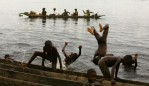 Congolese children spent casual afternoon at the Congo River in the village of Isangi March 22, 2007. The river and the forest are their life-line