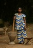 Woman takes a break from grinding manioc at the Village of Babogombe in Yoko National Reserve in the Orientale Province on March 25, 2007