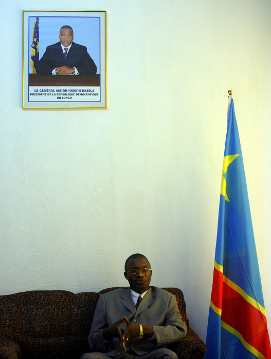 Joseph Bangakya, Vice Governor of Orientale Province elected in the historic election held in late 2006,  expresses his views and concerns on logging in his province at his office in Kisangani March 27, 2007. Photograph of Joseph Kabila, new president, is on the wall. After the election, DR Congo is in very critical period of transition, to part from old ways of corruption and way, to start anew.