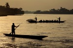 Evening commute on the Congo River on dug-out canoes in Kisangani , the capital of the Orientale Province in the Democratic Republic of Congo March 25, 2007.