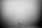 A pirogue crossing the Tshuapa River in early morning fog  ** signature image of collection **
