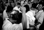 Victors of weekend long cock fighting, drinking, dancing in Rio Caguan town, Southern Colombia 2001