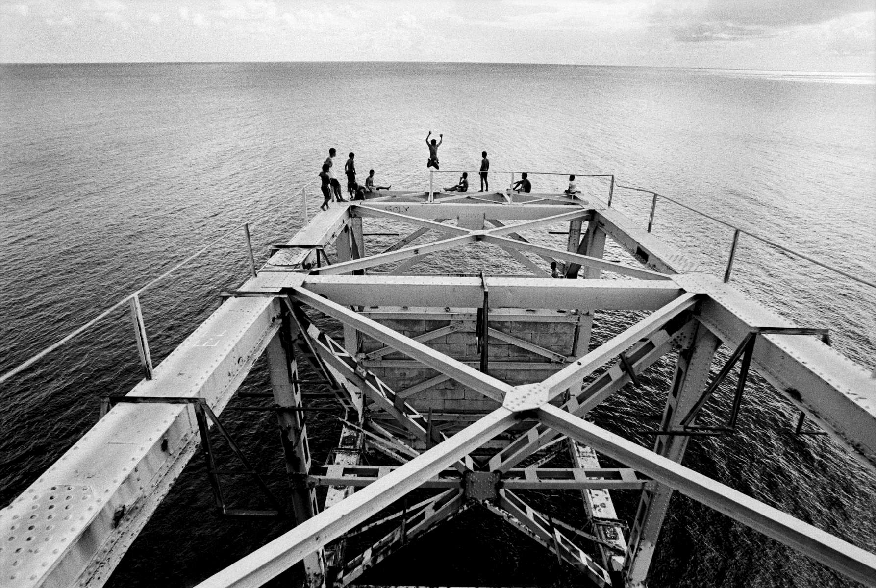 At high tide, children jumping off broken down loading docks, Republic of Nauru 2001