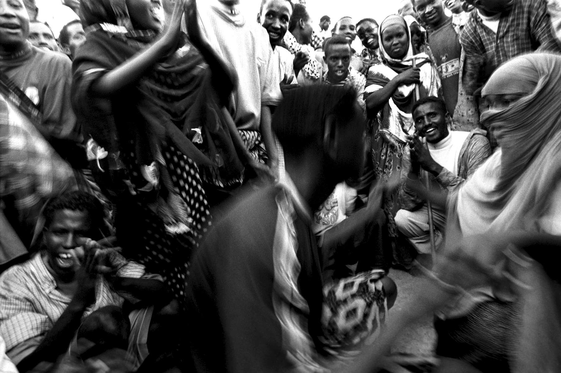 Dancing at the beginning of Bakr-id, an important Muslim festival, Mogadishu 2002