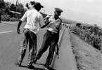 Matatu driver bribing a policeman, Kericho, Kenya 2001