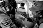 Gabonese ELF employees discussing upcoming work on an ELF petrol platform, Torpille, in the Atlantic. 2002