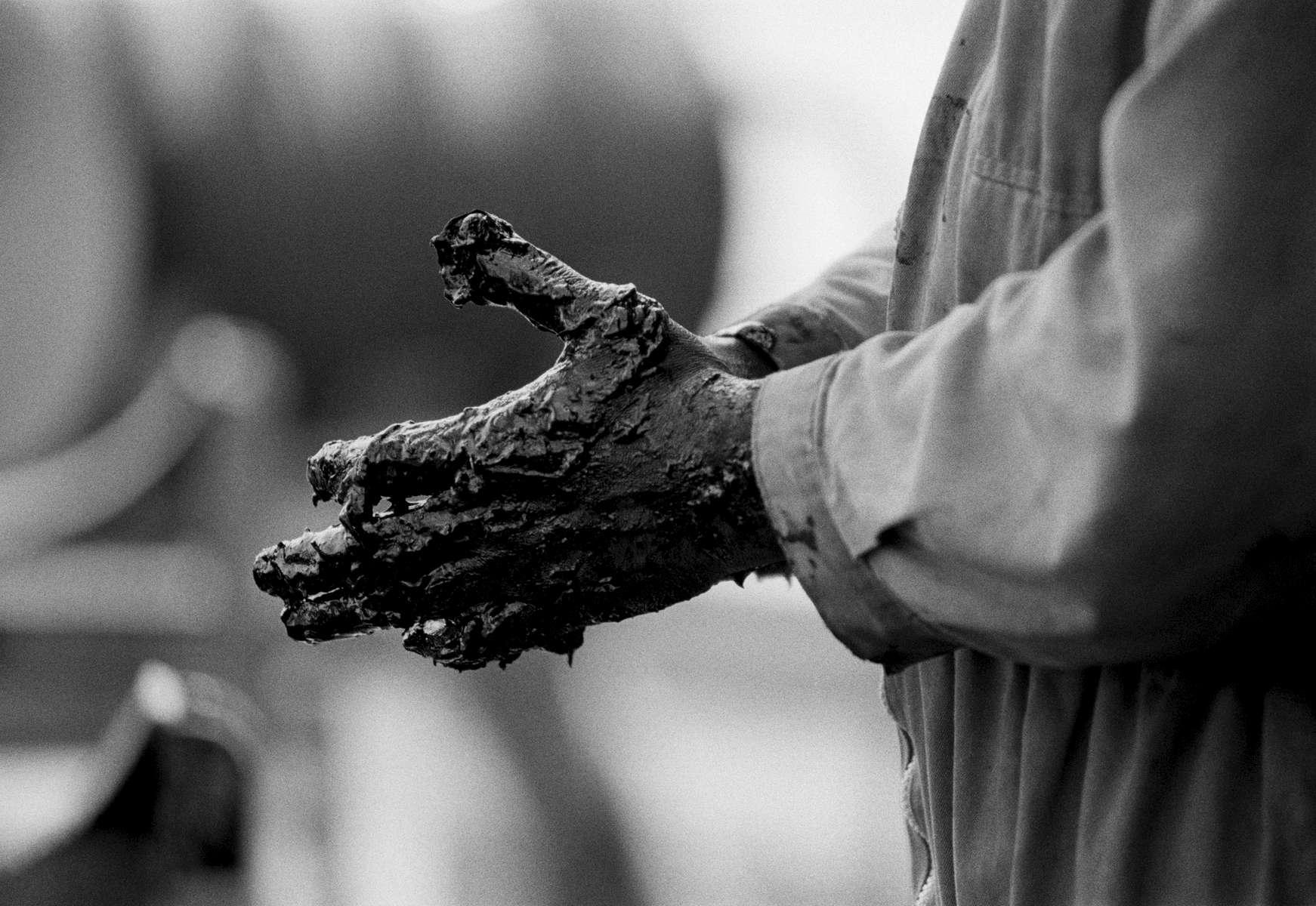 Worker's hands on Torpille, ELF petrol platform, off Gabon's equatorial coastline 2002