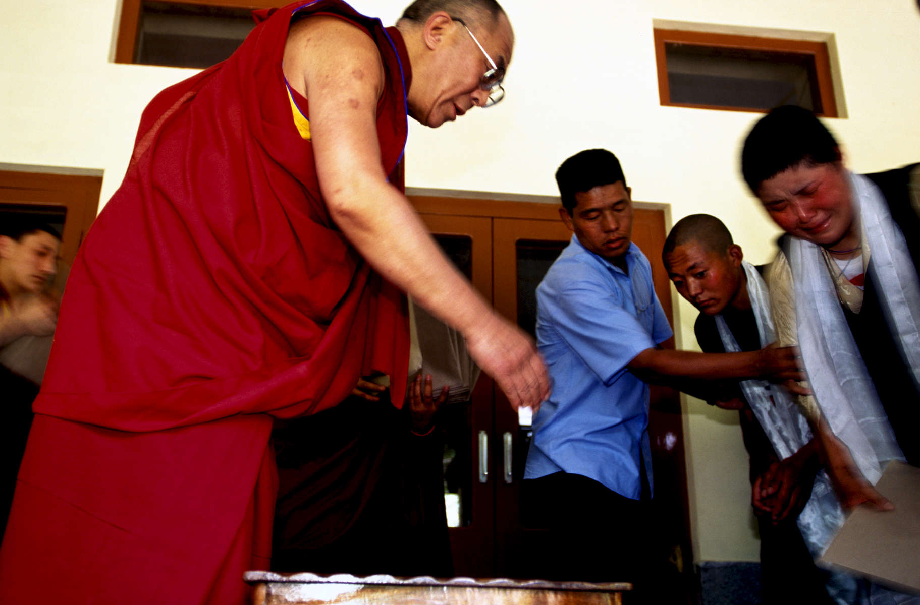 Tibetan refugees meeting their Holiness, the Dalai Lama for the first time in Mecleod Ganj, India. 1998