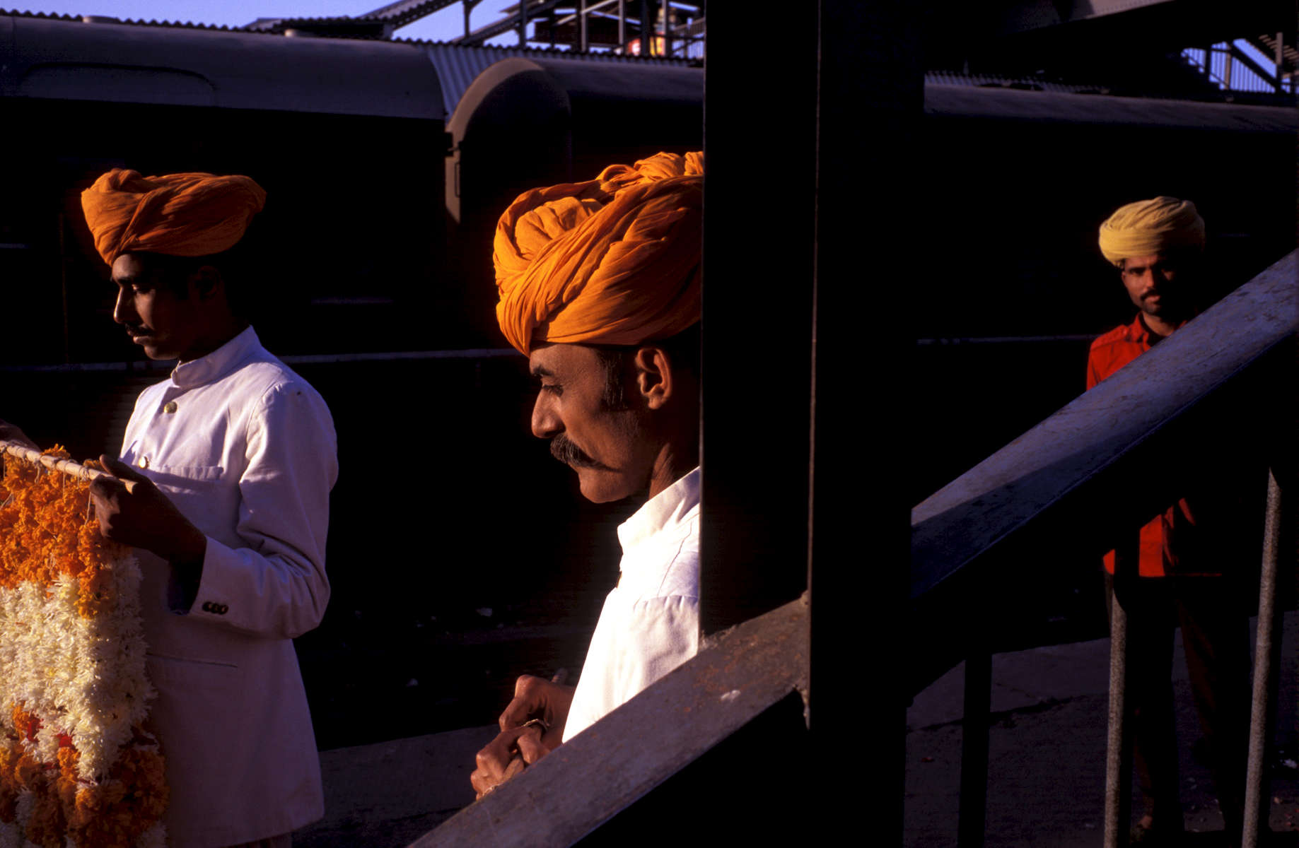 Waiting at the train station in Jodhpur, India for the Barat (groom) party to arrive and be greeted with garlands, flowered necklaces. The Barat party are from the Gaur clan from the northern state of Himalchel Pradesh. The royal wedding will unite the Rathore and Gaur clans. 1998