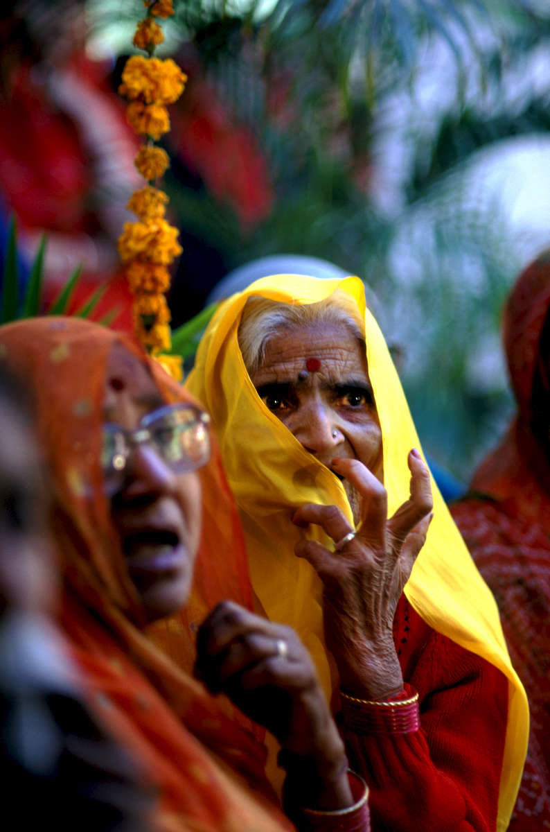 Elderly women singing at a royal wedding, who are the official singers and musicians of the Rathore clan. They sing at different auspicious occassions, particularly clan weddings in Jodhpur, India. 1998