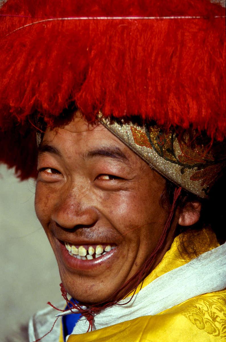 Portrait of a Tibetan man in traditional dress for the Harvest festival, Tibet 1992
