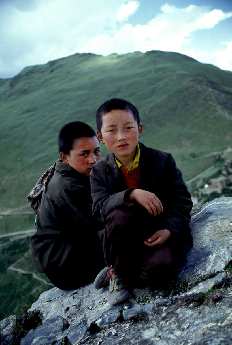 Young Tibetan monks on the ridge above Ganden monastery, Tibet 1992
