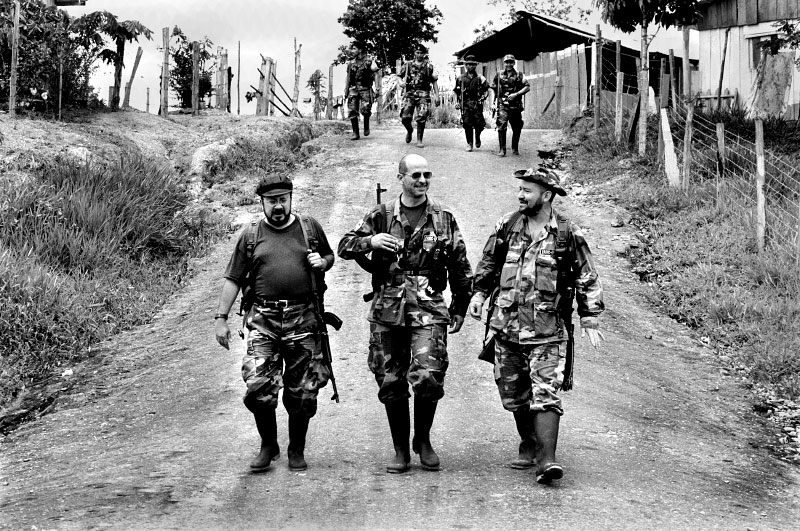 Three top commanders of the FARC < aliases: Simon Trinidad (middle), Carlos Antonio Lozada (right), ? (left) > during peace negotiations in Los Pozos, Southern Colombia 2000