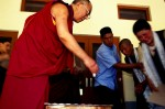 Dalai Lama receiving recent refugees who made the trek across the Himalayas