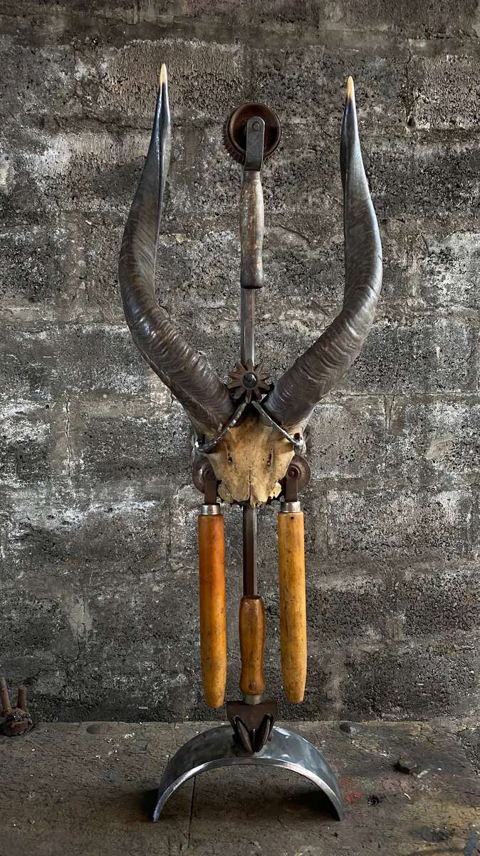 horns converted into a statue with industrial found piecesGIFT | NOT FOR SALE