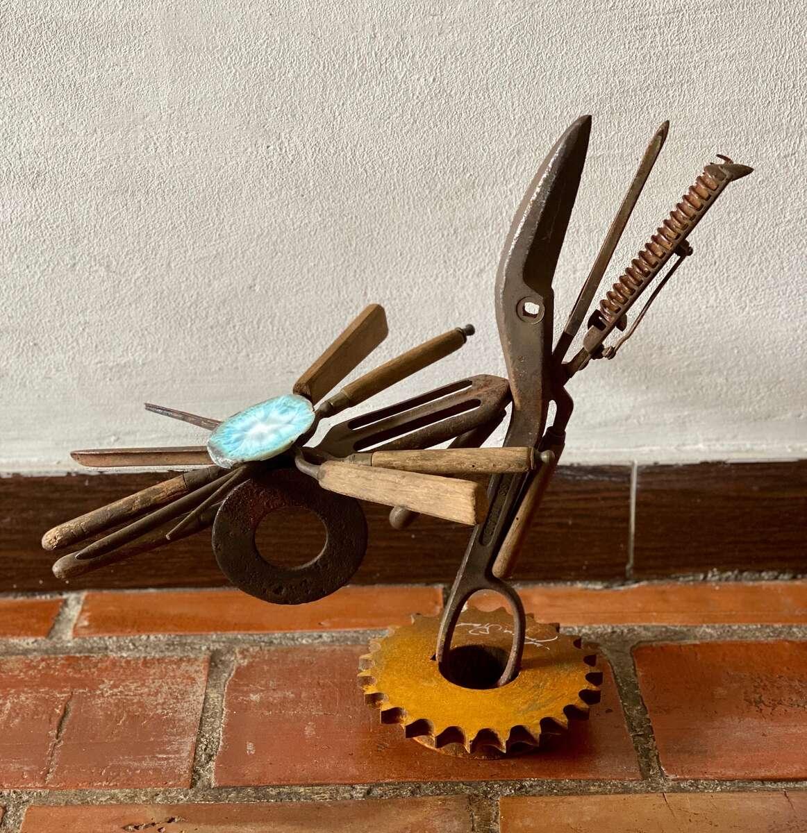 Mix of antique curling irons, scissor part, semi precious stone (Larimar) and found industrial pieces$800