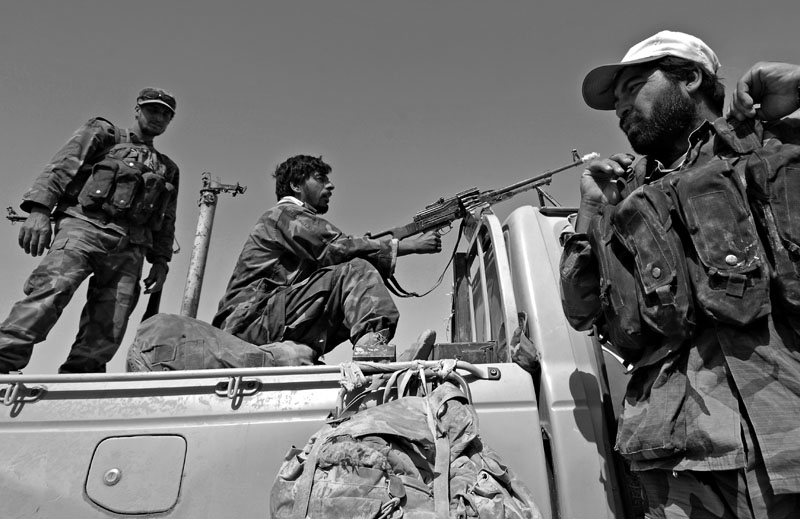 Afghan National Army soldiers prepare for a mission in Helmand Province, Afghanistan.