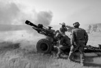 Nato artillery fire upon Taliban positions in Helmand, Afghanistan.