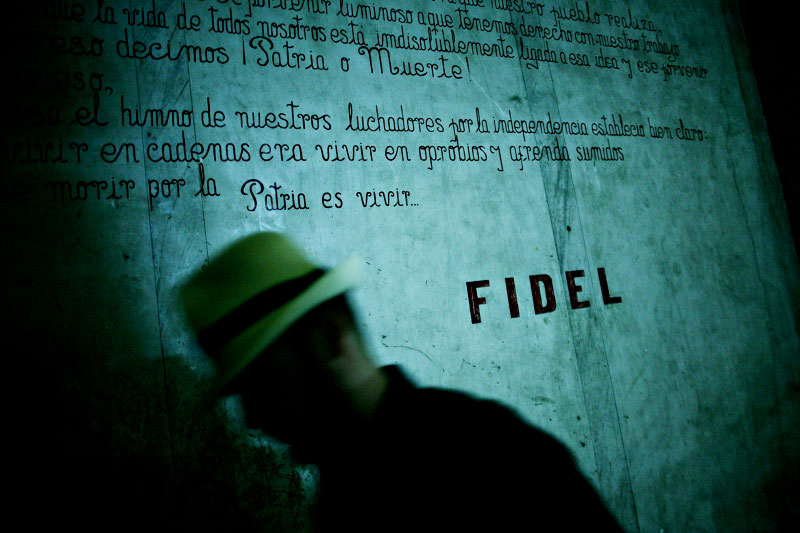 A man walks past a patriotic mural in Havanna, Cuba.