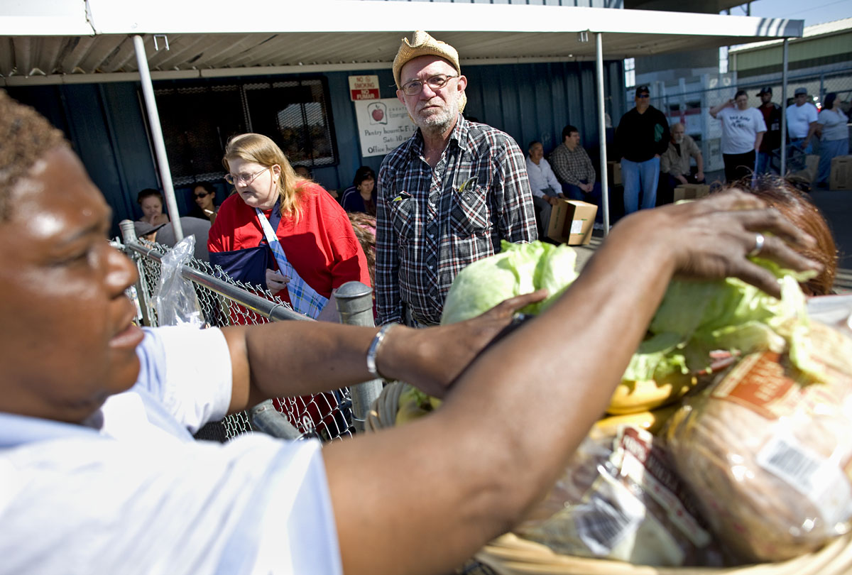 Clients use the emergency foodbank in Stockton, CA.