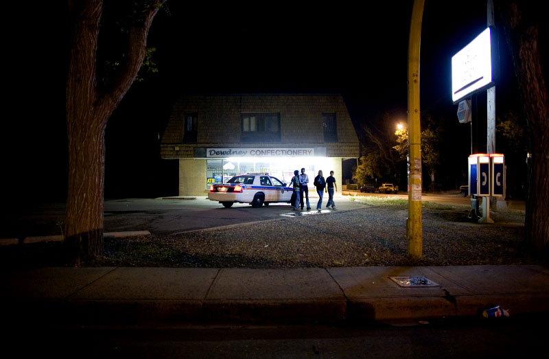Police on patrol talk to a group of young people in North Central, Regina late at night.