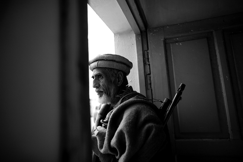 Ali stands guard at a religious party HQ in Peshawar, Pakistan.