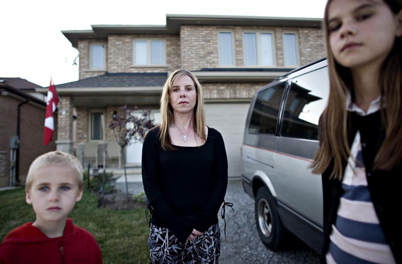 Angry resident Anne-Marie Vansickle stands with her children Kai and Kierra in the front yard of her home which edges onto the disputed land.