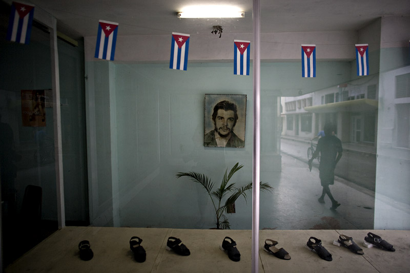 A portrait of Che Guevara adorns a display of shoes in Camaguey, Cuba.