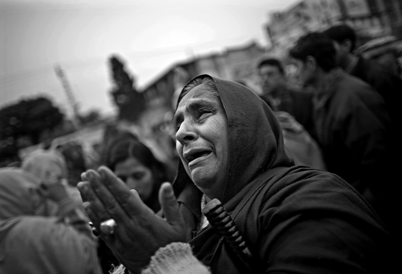 A woman mourns for slain leader Benazir Bhutto at the exact spot where she was killed by a massive car bomb.
