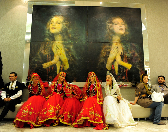 Traditional dancers relax before performing at the new Jumeirah Bilgah Beach Hotel on September 6, 2012 in Baku, Azerbaijan. (Photo by Denis Doyle/Getty Images)