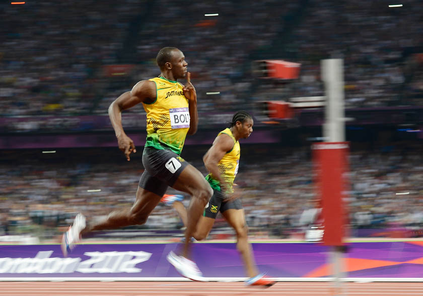 Usain Bolt of Jamaica beats 2nd placed Yohan Blake of Jamaica to win the Men's 200m Final of the London 2012 Olympic Games at Olympic Stadium on August 9, 2012 in London, England. (Photo by Denis Doyle/Getty Images)