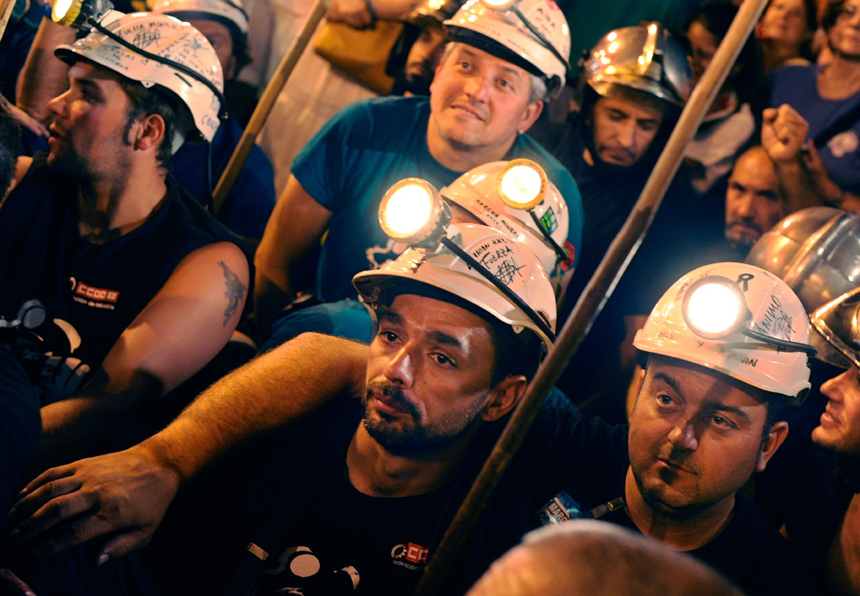 ADRID, SPAIN - JULY 11:  Miners rest after arriving at Puerta del Sol square after marching from the northern Spanish regions of Asturias and Leon in the early hours of  July 11, 2012 in Madrid, Spain. The miners had marched to Madrid in protest at industry subsity cuts.  (Photo by Denis Doyle/Getty Images)