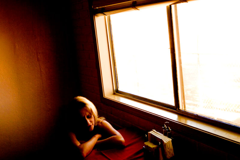 Sex worker Lexi Lovelace waits for dinner in the Bunny Ranch's dining room.