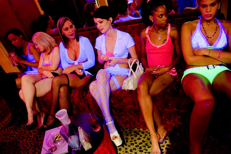 Sex workers, from left, Nina Nicole, Rhiannon, Erin Daye, Mila Moore, Kitten, and Skye High wait for customers in the Bunny Ranch's parlor.
