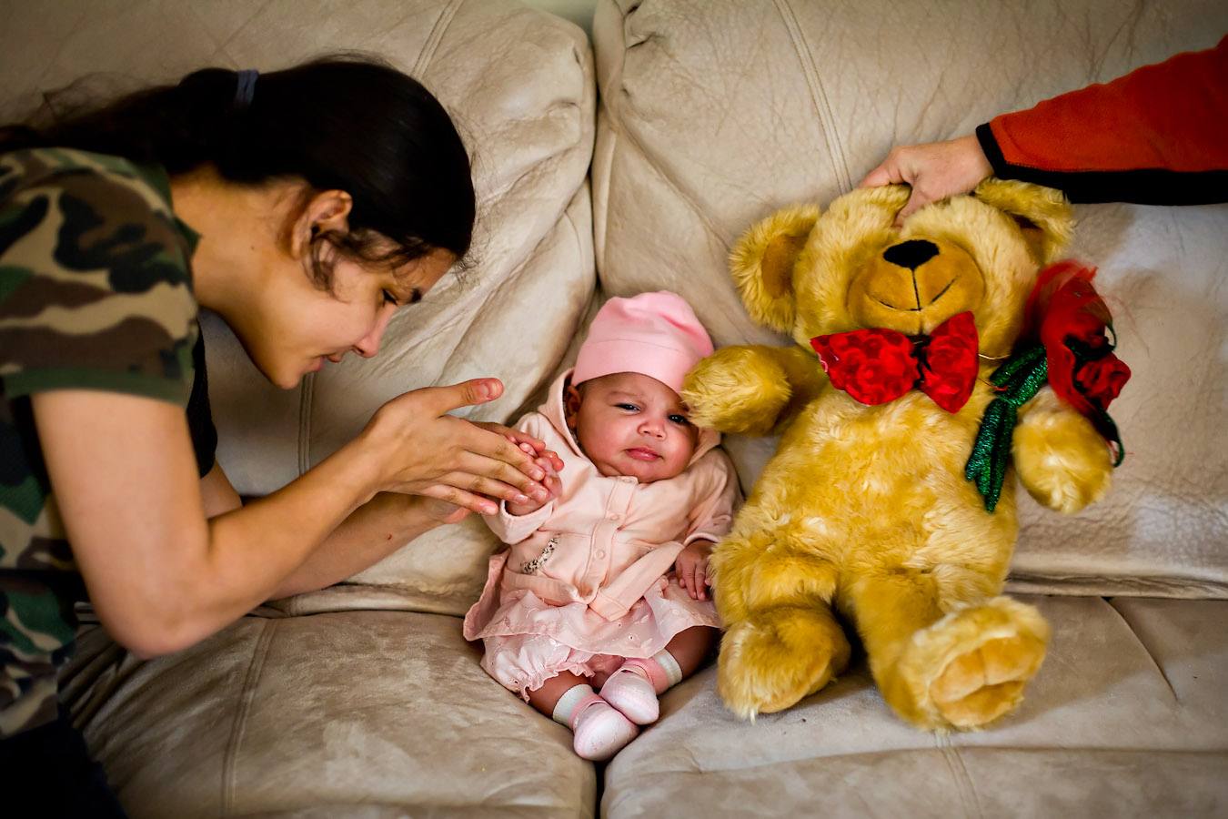 """Jessica feels her daughter's hand while Hector places a stuffed bear next to her on the couch. Jessica says, """"I won't put anybody ahead of her. She goes first now in my life. She's my priority. Yeah I can teach her as a mom, but she can teach me as a kid. She can probably do thing I never could."""""""