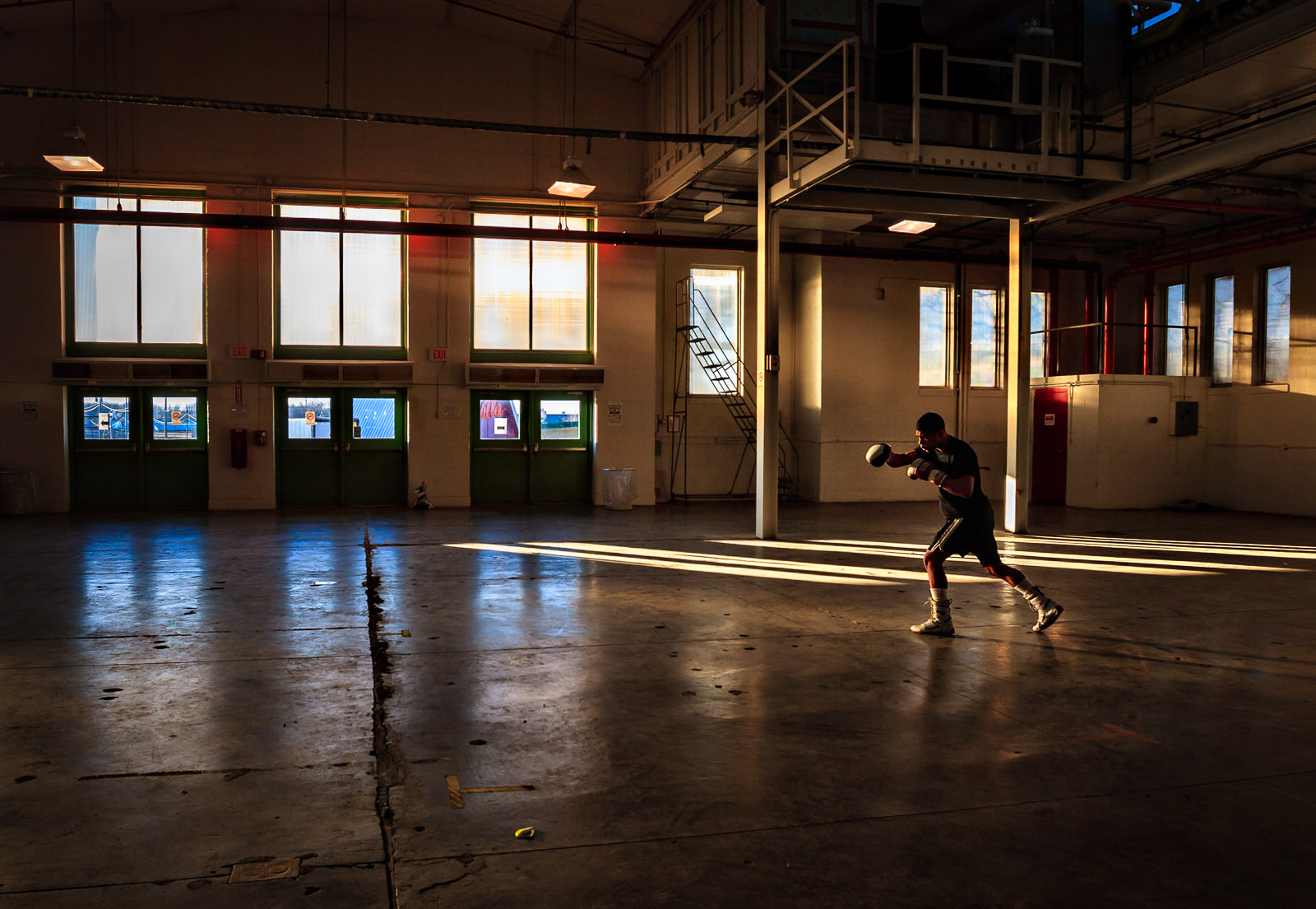 A boxer competing in the New York Amateur Golden Gloves tournament warms up away from the main ring inside a building on the New York State fairgrounds.Photograph by Jesse Neider