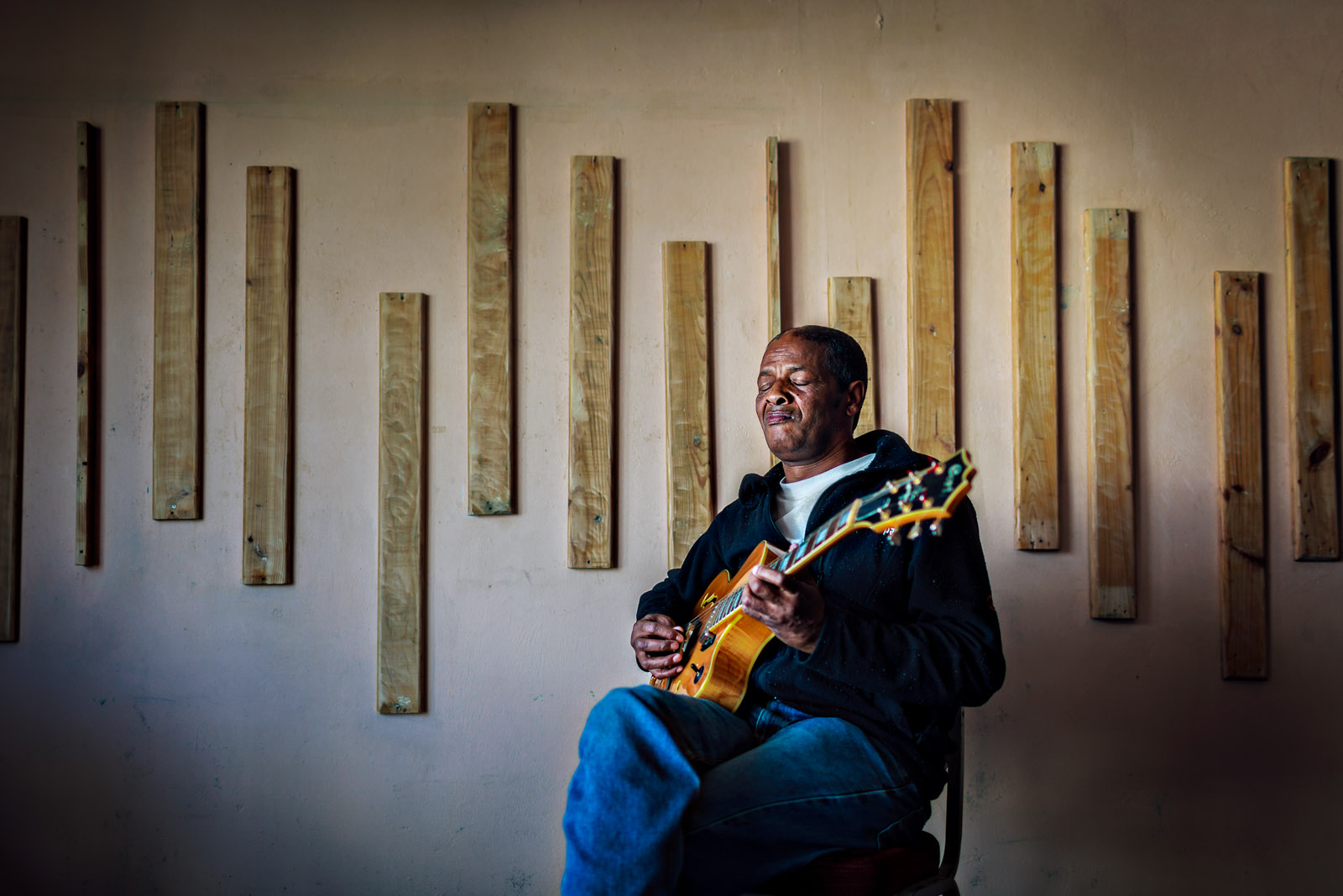 Legendary jazz guitarist Mac McKenzie is often credited with the re-emergence of goema, the unique music of Cape Town City. He is photographed in the bedroom of his home outside of Cape Town, South Africa in 2009.Photograph by Jesse Neider