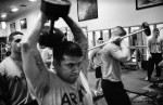 US infantry soldiers (of Bravo Company, 1-32nd Infantry Regiment) excercise and lift weights in the gym at Fort Drum, New York.