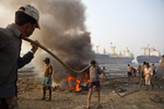 Cable carriers in front of toxic fire of burning styrofoam
