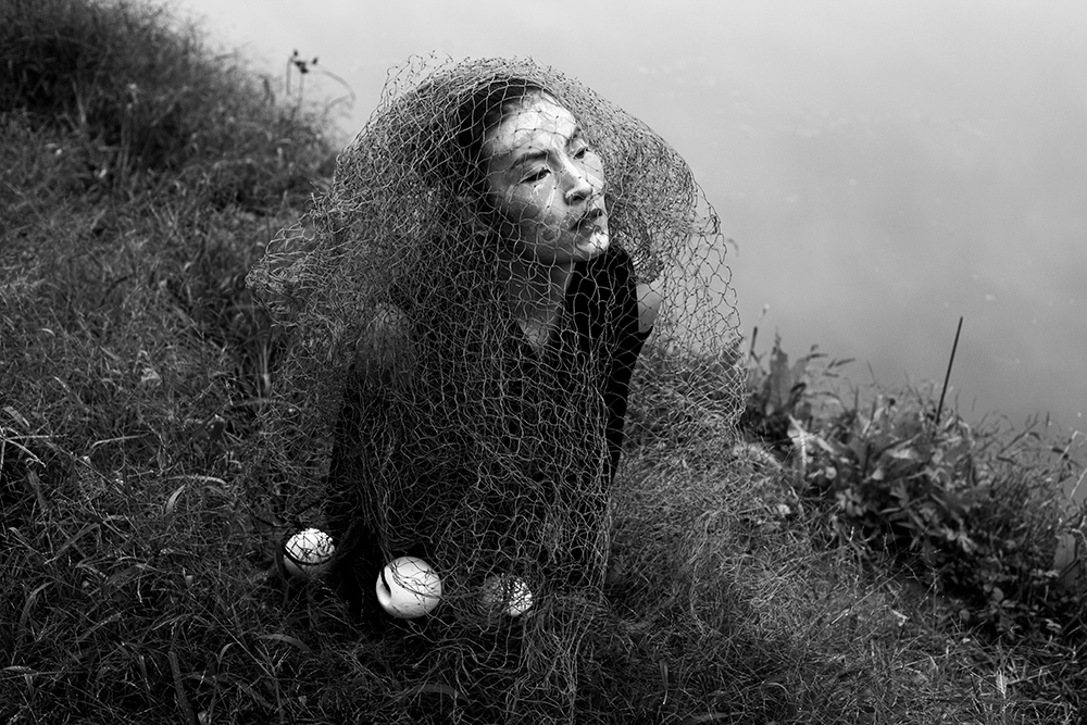 """Beijing, Oct. 2, 2017 : Multi artist Han BIng performs by the Wenyu river on the outskirts of Beijing, China.Performance artists had been in the vanguard of China's art scene as it opened up to Western ideas and values in the 1980s, testing the limits of the law and social norms according to Reuters.But increased pressure on many forms of art, which comes as President Xi Jinping has been shoring up Communist Party control over all aspects of society, has had a chilling effect on the performance art scene in particular.In 2014, Xi urged all artists to """"carry forward the banner of socialist core values"""".As a result of this policy artists such as Han Bing have seen performances cancelled and shifted to  locations where there performances at best are documented by  storytellers before they fade into the archives."""