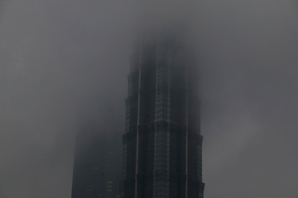 The top of Shanghai's World Financial Centre seen during a heavily polluted day. Air pollution is a major environmental issue in fast developping economies such as China. {quote}Air pollution can increase the impact of climate change as heavy air pollution can worsen droughts and flooding simultaneously in different regions by strongly affecting cloud effects{quote} according to scientists from the University of Maryland. Photo by @hessekatharina#shanghai#climatechangeisreel #climatechange#airpollution #smog#katharinahesse #china#金茂大厦