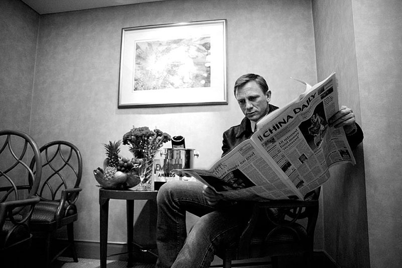 Beijing, January 29, 2007 : Daniel Craig aka James Bond reads a paper in a hotel.