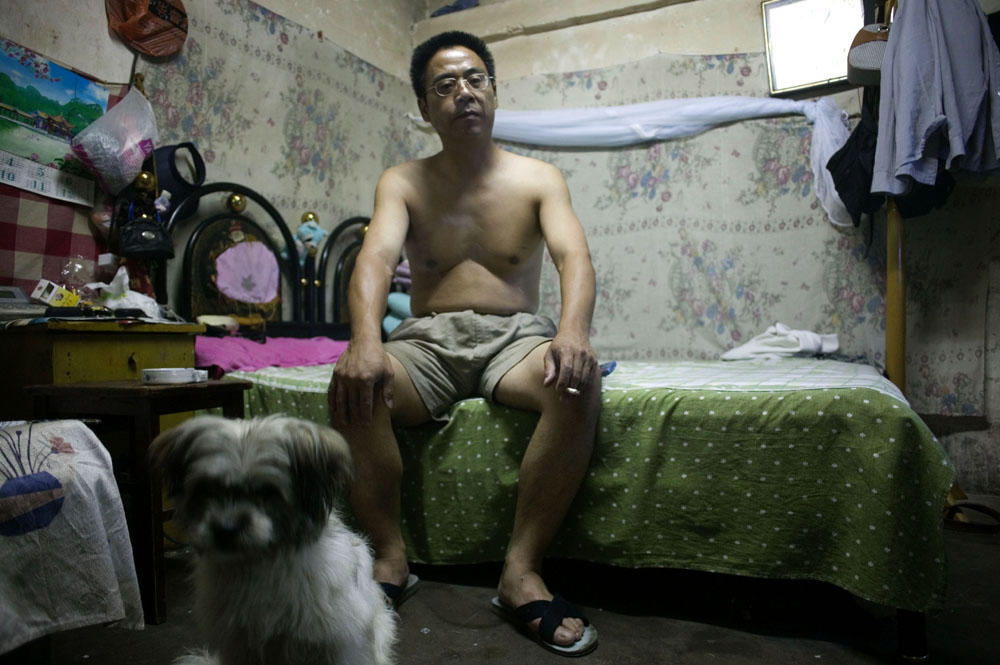 August 2007 : Mr X, a worker without a registration ( hukou) , spends the last days in his modest apartment before he decides to look for another refuge. ( his home was demolished later on )