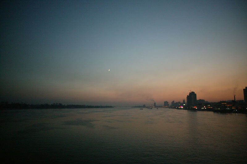 The Yalu river that divides North Korea (L) and China (R), Dandong