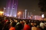 hundreds of construction workers watch movies in an open-air cinema for migrants, Beijing, August 2007