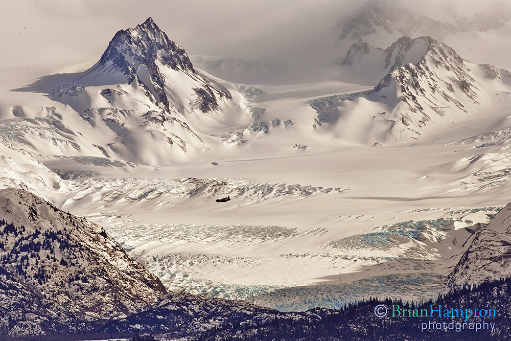 Scale of mountains and glacier with a C130 left of center