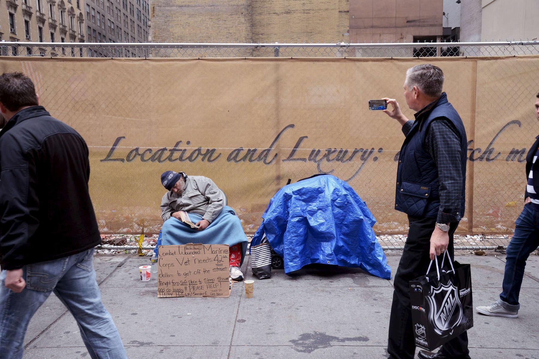 Homeless veteran on Fifth Avenue, Manhattan – December, 2015